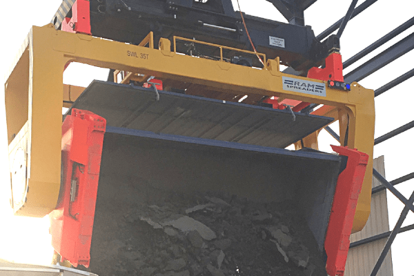 Revolver on a reach stacker unloading copper concentrate - RAM Spreaders