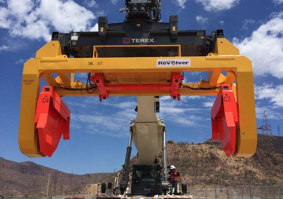 Rotating spreader for inland bulk logistics